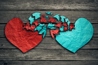 Romantic relationship concept as two hearts made of torn crumpled paper on weathered wood as symbol for romance attachment and exchange of feelings and emotions of love.-1